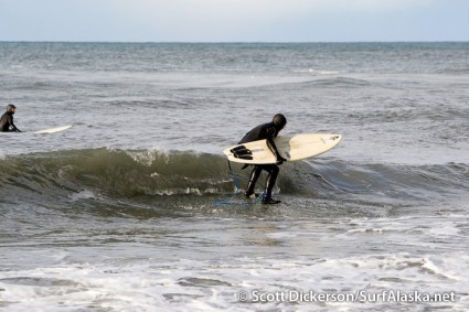 Jake Bell surfing ice in Anchor Point, Alaska.