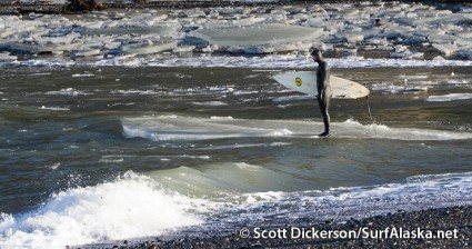 Jake Beaudoin riding ice out to the surf break. Anchor Point, Alaska