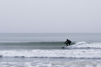 Jake Beaudoin surfing Alaska on a snowy day.