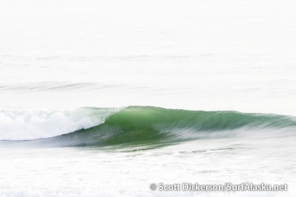 Glassy surf dream emerging out of the flat light in Yakutat, Alaska.
