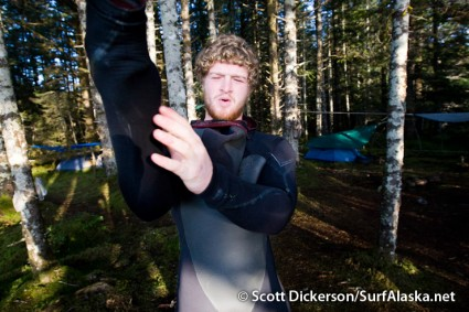 Jake performs the morning ritual of gasps and moans as he crawls into his cold damp wetsuit.