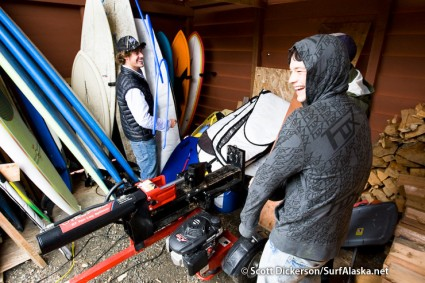 Checking out the rental boards at Icy Waves surf shop. They are there in the wood shed, behind the wood splitter.