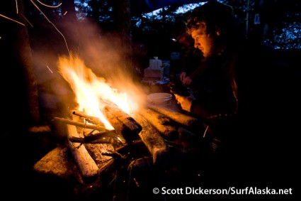 Back at the campfire Jake begins the long wait for dawn patrol. Yakutat, Alaska.