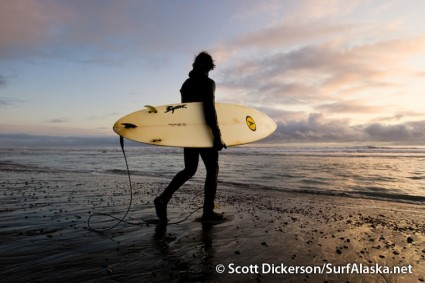 Matt Kinney heading back out for another surf session at Snappers, Yakutat, Alaska.