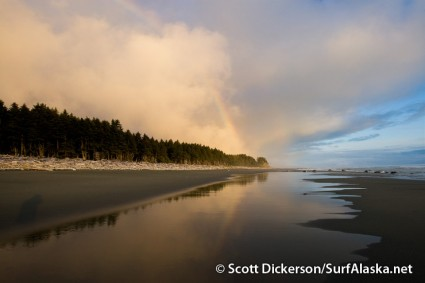Rainbow just before sunrise at Snappers surf beach, Yakutat, Alaska.