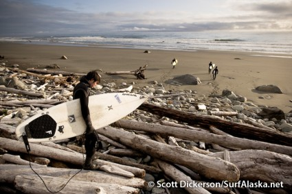 Keith Bell navigates the driftwood approach at Snappers. Surfing Yakutat, Alaska.