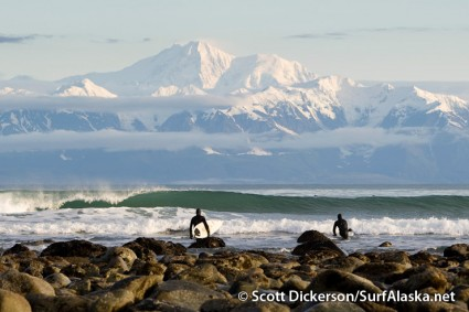 Keith Bell and Dan Stafford starting their day off right with a sunrise surf at Pt Carrew, Yakutat, Alaska.