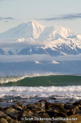 Glassy morning surf at Pt Carrew with the St Elias Range backdrop, Yakutat, Alaska.