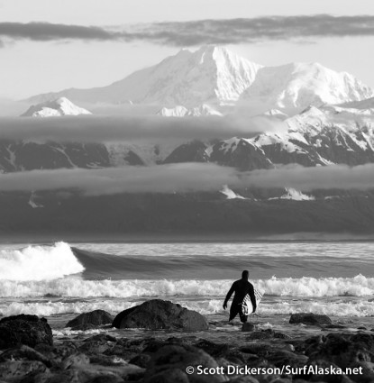 Jake Beaudoin walking into a timeless surfing scene, Yakutat, Alaska.