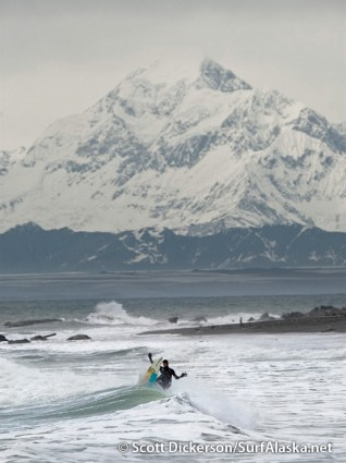 California surfer Chris Del Moro doing his thing beneath Mt St Elias, Yakutat, Alaska.