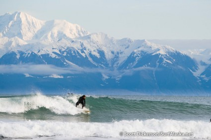 Jake Beaudoin surfing Yakutat, Alaska beneath the towering Saint Elias Mountains.