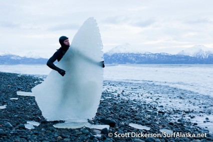 Jake Bell, a true Alaskan surfer, posing on the beach with a 300lb square tail fish.