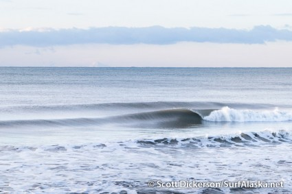I checked this spot earlier in the day. The surf was perfection, but with the rising tide it wasn't going to last long.