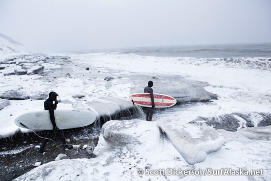 Gart Curtis and Mike McCune walking a  path through the ice to the waves on Cook Inlet, Alaska.