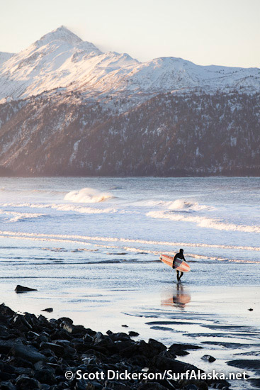 Mike McCune walking out of a winter surf paradise.