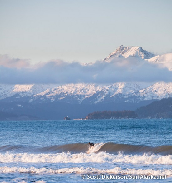 Mike McCune surfing Alaska on a winter sunrise.