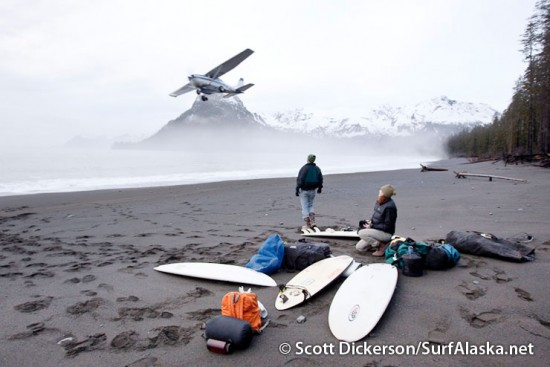 Mike and Stephanie watch as the plane departs Petrof Glacier Beach, Alaska.