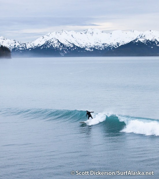 Iceman surfing a remote surf break in Alaska near Petrof Glacier.