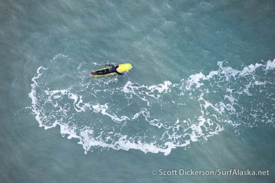 Aerial photo from a paramotor of surfing in Alaska.