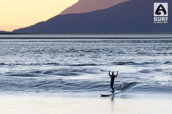 Stand up paddle surfing the Turnagain Arm bore tide in Alaska.