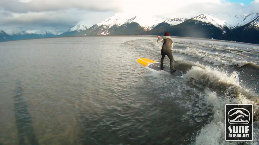 Still frame from the GoPro video - Jeff Hoke stand up surfing the Turnagain Arm boretide.